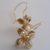 Four-pod rose gold hook earrings