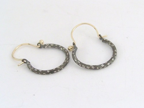 Silver and gold hoop earring