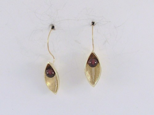Half-pod with garnet hook earrings