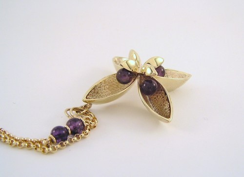 Four-pod gold and amethyst pendant