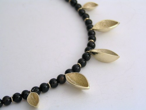 Gold and onyx multiple half-pod necklace
